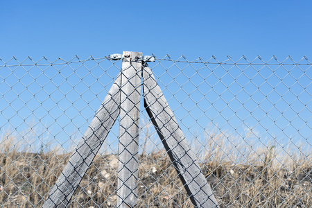 fence wire: Wooden posts with fence wire Stock Photo