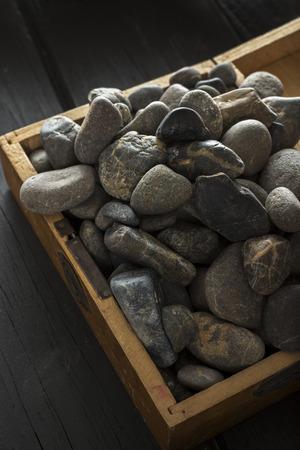 black pebbles: black pebbles in a wooden box