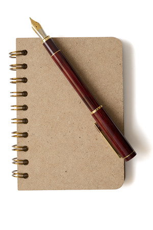 notebook: notebook and fountain pen isolated on white