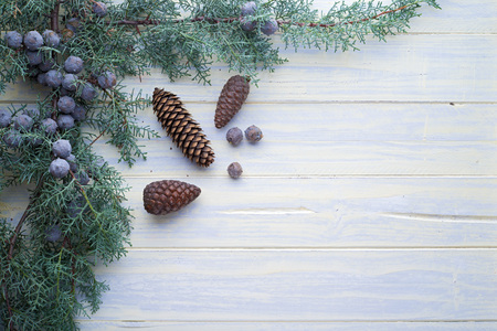 christmas tree decoration: Christmas background framed with spruce branches on white-painted wood
