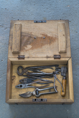 toolbox: Old wooden toolbox on concrete background