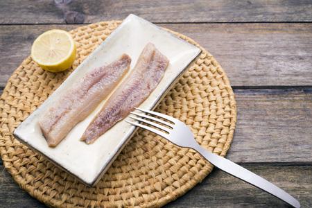 sardines: Rustic platter of smoked sardines with lemon
