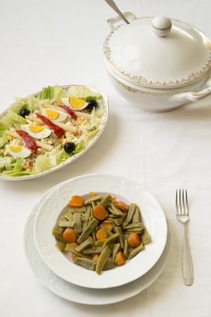 tureen: salad of green beans and carrots. the bottom potato salad and a soup tureen