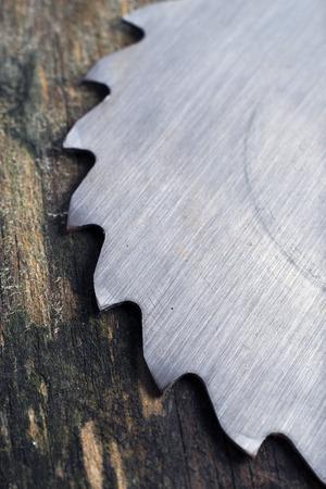 circular saw: circular saw blades on wooden background Stock Photo
