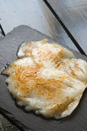 cod oil: smoked cod seasoned with olive oil and paprika Stock Photo