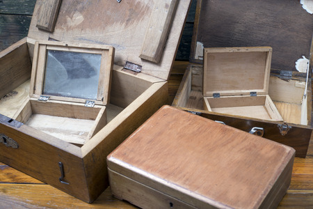 fragile industry: old wooden boxes for personal items