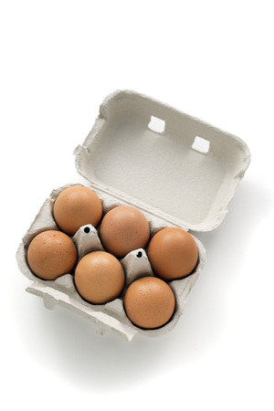 egg carton: half a dozen eggs in an egg carton. isolated on white background Stock Photo