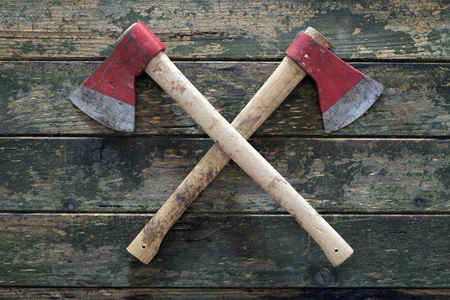 axe: two crossed axes on a wooden background