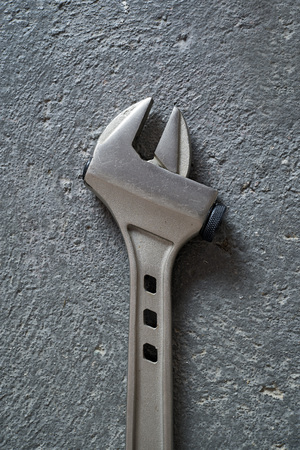 hardware repair: Adjustable wrench over concrete background