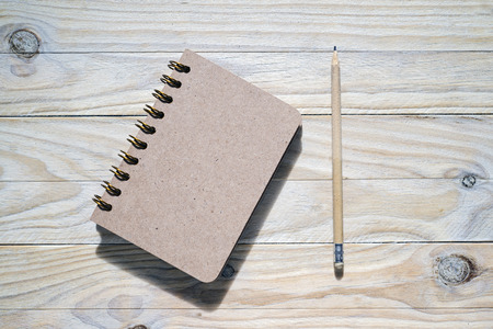 annotation: pen and notebook on wooden table