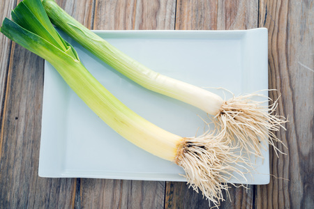 leeks: leeks  on wooden table Stock Photo