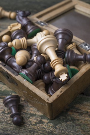 chessmen: chessmen on a wood box on an old table