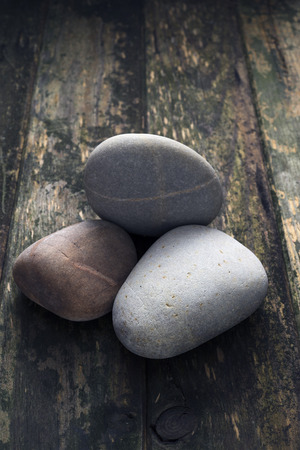 geological feature: Pile of pebbles over wooden background