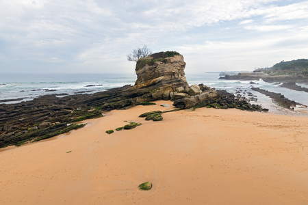 El Camello beach (Santander,Spain). In the background Mouro Island and lighthouse looks Stock Photo