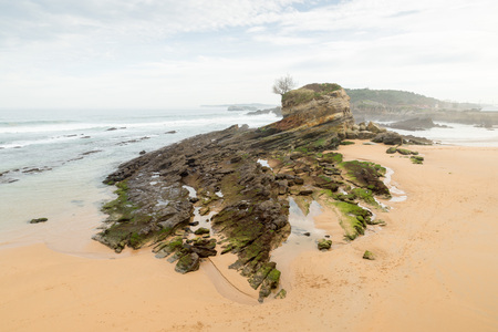 madalena: El Camello beach (Santander,Spain). In the background Mouro Island and lighthouse looks Stock Photo