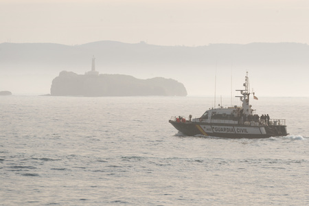 smuggling: SANTANDER, SPAIN - JANUARY 26, 2016: Guardia Civl patrol boat in the Bay of Biscay, off the coast of Santander Editorial