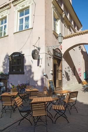 vilnius: VILNIUS, LITHUANIA - JUNE 7, 2016: Outdoor restaurant in Vilnius on beautiful summer day
