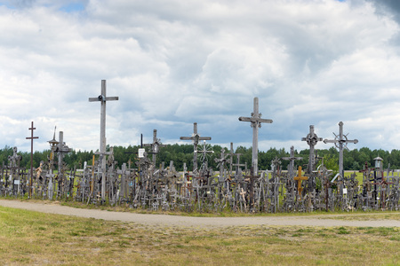 heaped: hill of crosses, Kryziu kalnas, Lithuania, a place of worship for Christians.