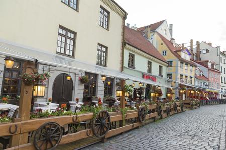 riga: RIGA, LATVIA - JUNE 9, 2016: Street cafe in downtown of Riga
