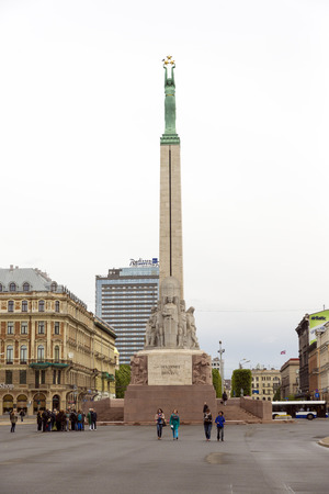 honouring: RIGA, LATVIA - JUNE 10,2016: The Freedom Monument  is a memorial located in Riga, Latvia, honouring soldiers killed during the Latvian War of Independence (1918–1920)