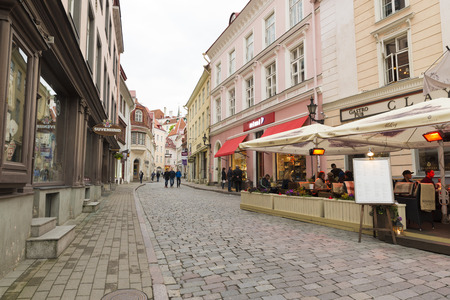 nights: TALLINN, ESTONIA- JUNE 11, 2016: Unidentified people enjoy the streets of the historic center of Tallinn during the white nights, almost at the summer solstice Editorial