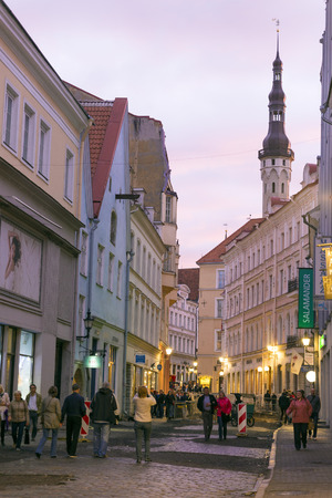 solstice: TALLINN, ESTONIA- JUNE 11, 2016: Unidentified people enjoy the streets of the historic center of Tallinn during the white nights, almost at the summer solstice Editorial