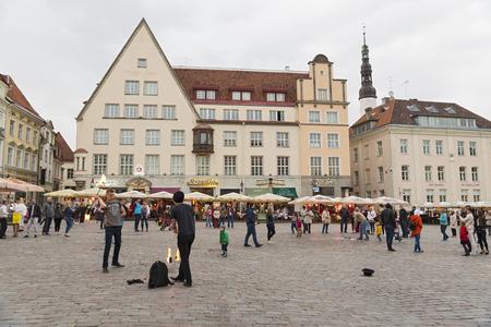 estonian: TALLINN, ESTONIA- JUNE 11, 2016: Unidentified people in Tallinn Town Hall and Raekoja Square in the midnight, Tallinn, Estonia