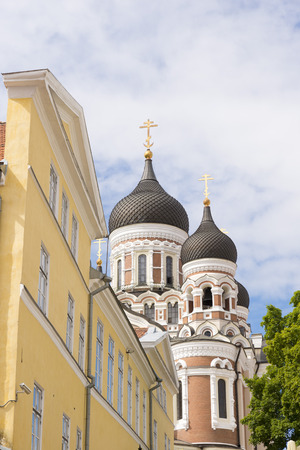 Central street in Tallinn, in the background Alexander Nevsky Cathedral domes, an Orthodox Cathedral in the Old Town Tallinn, Estonia. Stock Photo