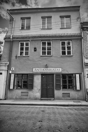 antiquarian: VILNIUS, LITHUANIA - JUNE 8, 2016: Facade of an antique shop. Processed in black and white