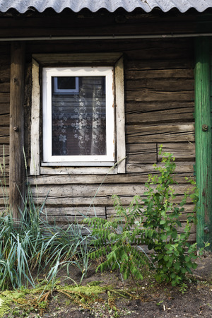 casing paper: window of a ramshackle wooden house. vintage processing