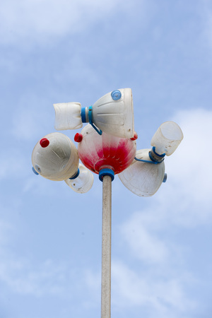 pet bottles: Windmill made out of PET bottles against a blue sky
