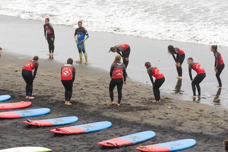 surfers: LAS PALMAS DE GRAN CANARIA, SPAIN - JULY 29, 2016: Class surfers on the beach Las Canteras, Las Palmas Editorial