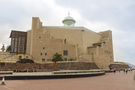 constituting: LAS PALMAS DE GRAN CANARIA, SPAIN -  AUGUST 3, 2016: Alfredo Kraus Auditorium is located in Las Palmas constituting one of the most unique buildings in the capital of Gran Canaria. Created by Oscar Tusquets, it was built between 1993 and 1997 Editorial