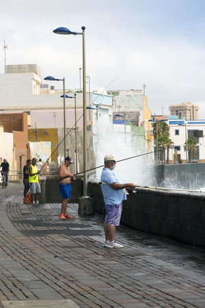 cristobal: LAS PALMAS, GRAN CANARIA, SPAIN - JULY 31, 2016: view fishing district of San Cristobal, south of Las Palmas in Gran Canaria, Canary Islands. Neighbors fish from their doorsteps Editorial
