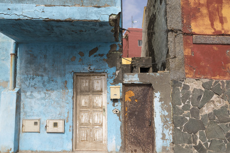 cristobal: Fishermen houses in the neighborhood of San Cristobal, in Las Palmas, Gran Canaria, Canary Islands. The facades are damaged by the proximity to the sea