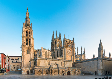 decades: BURGOS, SPAIN - 1 SEPTEMBER, 2016: View of the Cathedral at sunrise. Construction on Burgos Gothic Cathedral began in 1221 and spanned mainly from the 13th to 15th centuries. It has been declared a UNESCO World Heritage Site