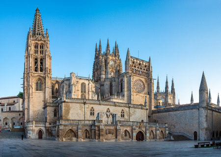 spanned: BURGOS, SPAIN - 1 SEPTEMBER, 2016: View of the Cathedral at sunrise. Construction on Burgos Gothic Cathedral began in 1221 and spanned mainly from the 13th to 15th centuries. It has been declared a UNESCO World Heritage Site