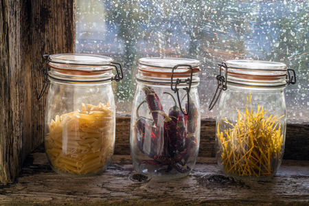 larder: Pantry in the windowsill of an old window Stock Photo