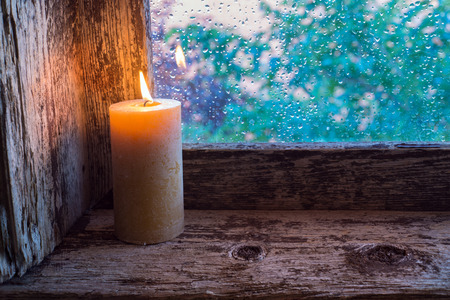 embrasure: Burning candle on the sill of a window. Christmas ornament