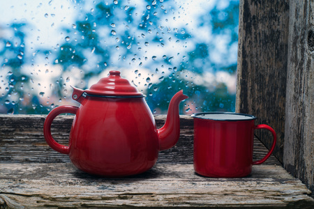 splintered: teapot and cup on the windowsill