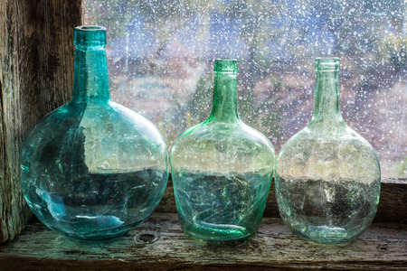 Carafe glass in a window sill