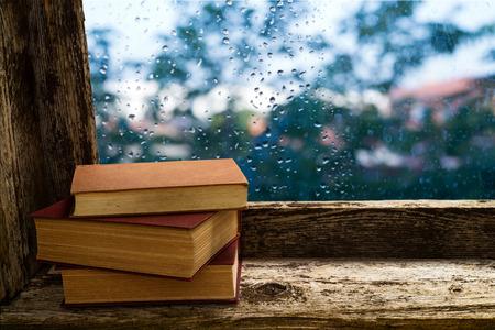 windowsill: books on the windowsill of an old wooden window