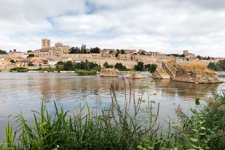 boatman: View of the Duero River through Zamora with the silhouette of the cathedral