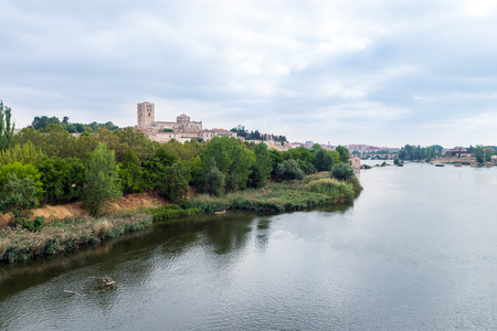 castille: View of the Duero River through Zamora with the silhouette of the cathedral