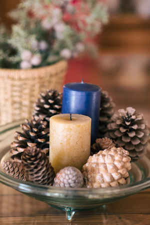 pinecones: tray decorated with candles and pinecones Stock Photo