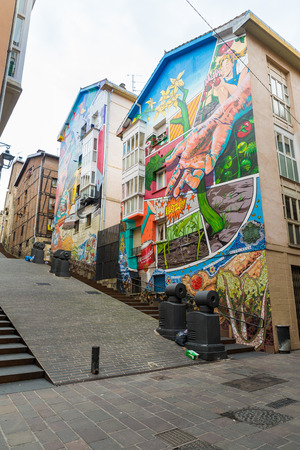 gasteiz: VITORIA-GASTEIZ, SPAIN - OCTOBER 16, 2016: Paint houses of the Mural Itinerary  in Vitoria, Spain. The IMVG creates murals on the facades of buildings in the medieval quarter of Vitoria.