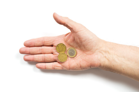 pauper: male hand holding some coins. isolated on white background