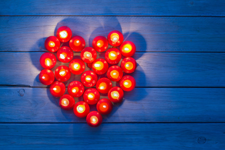 Heart made of burning red candles