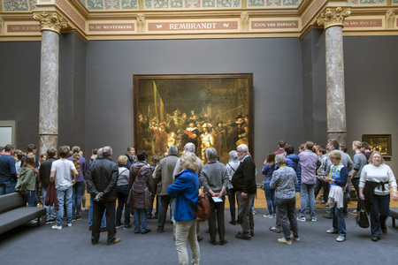 frans: AMSTERDAM, NETHERLANDS - MAY 10, 2017: People watching the picture The Night Watch or The Militia Company of Captain Frans Banning Cocq of Rembrandt, in the Rijksmuseum