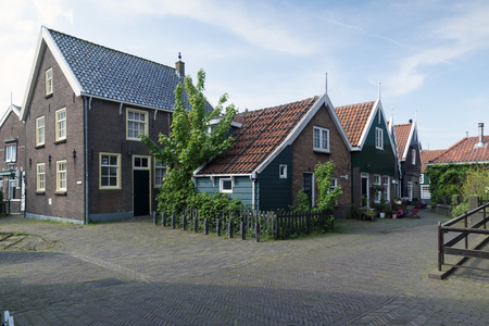 markermeer: MARKEN - NETHERLANDS - MAY 12, 2017:  is a village in the municipality of Waterland  in the Netherlands. Marken forms a peninsula in the Markermeer and was formerly an island in the Zuiderzee. The characteristic wooden houses of Marken are a tourist attra